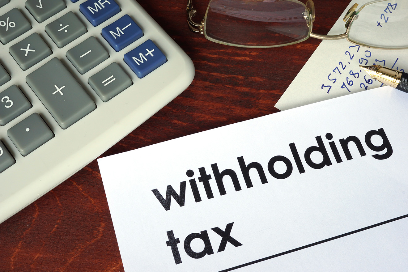 Crystallising withholding tax liability